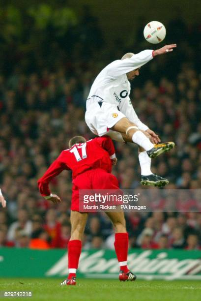 Manchester United's Juan Sebastian Veron takes to the air to beat Liverpool's Steven Gerrard during the Worthington Cup Final at the Millennium...