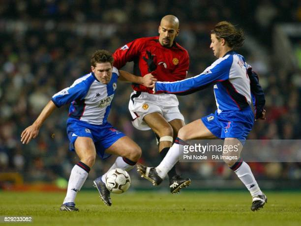 Manchester United's Juan Veron battles with Blackburn's David Dunn and Tugay during their Worthington Cup semifinal 1st leg match at Old Trafford...