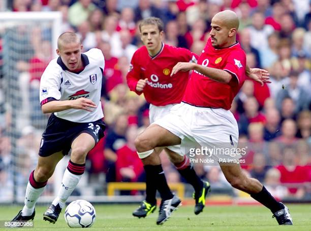 LEAGUE Manchester United's Juan Veron challenges Fulham's Sean Davis during the FA Barclaycard Premiership game at Old Trafford Manchester