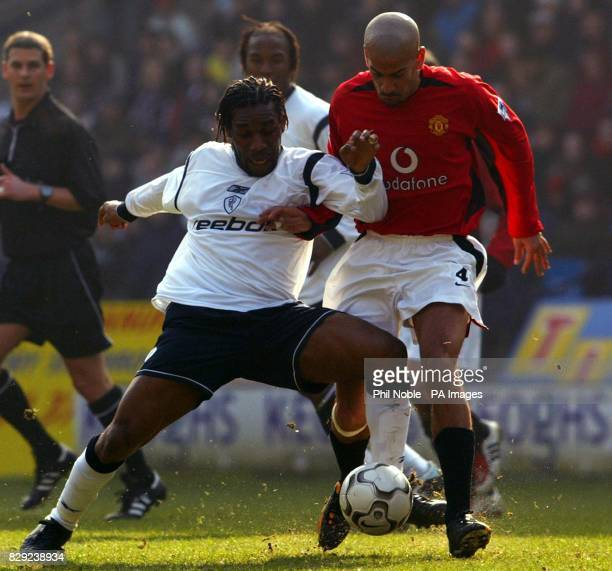 Manchester United's Juan Veron challenges Jay Jay Okocha of Bolton Wanderers for the ball during their FA Barclaycard Premiership match at Bolton's...