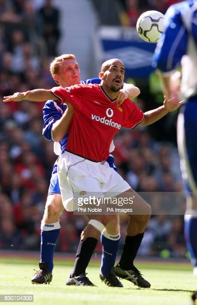 Manchester United's Juan Veron challenges Mark Pembridge of Everton during the FA Barclaycard Premiership game between Manchester United and Everton...
