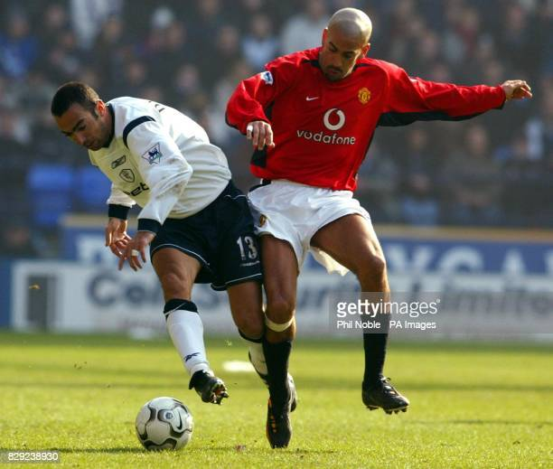 Manchester United's Juan Veron challenges Youri Djorkaeff of Bolton Wanderers for the ball during their FA Barclaycard Premiership match at Bolton's...