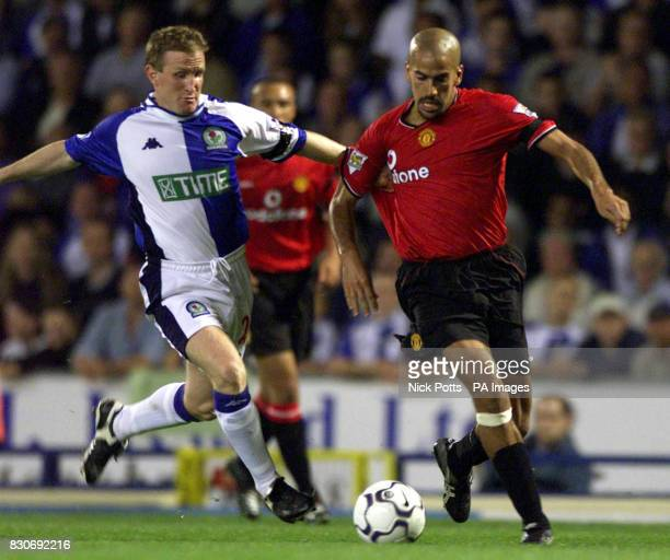 LEAGUE Manchester United's Juan Veron has his shirt pulled by Blackburn Rovers' defender John Curtis during the FA Barclaycard Premiership game at...