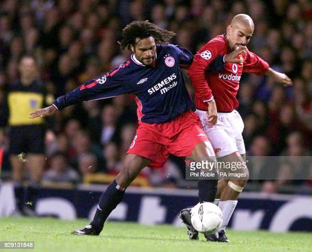 Manchester United's Juan Veron is held off by Olympiakos's Christian Karembeu during the UEFA Champions League Group G match at Old Trafford...
