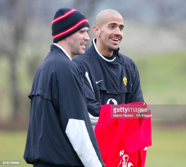 Manchester United's Juan Veron right shares a joke with Roy Keane in a training session at the Carrington training ground Manchester prior to the...