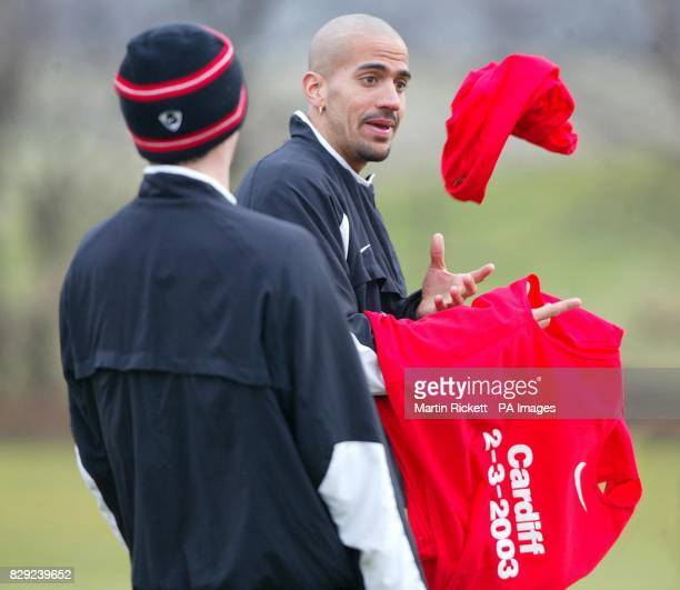 Manchester United's Juan Veron shares a joke with Roy Keane during a training session at the Carrington training ground Manchester prior to the...