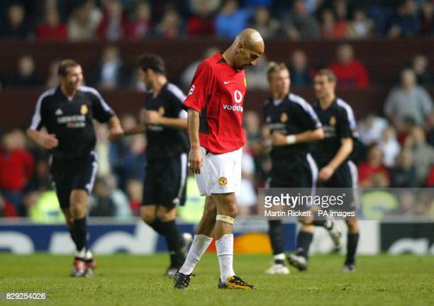 Manchester United's Juan Veron shows his dejection after Real Madrid's 3rd goal during their Champions League quarter final 2nd leg match at Old...