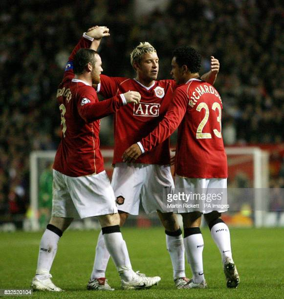 Manchester United's Kieran Richardson celebrates with teammates Alan Smith and Wayne Rooney after scoring against FC Copenhagen during the Champions...