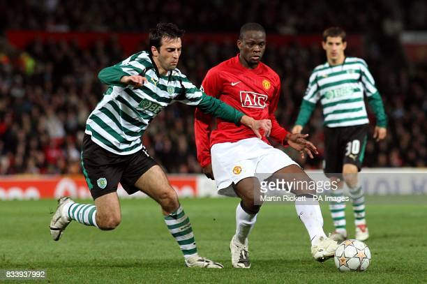Manchester United's Louis Saha and Sporting Lisbon's Antonio Souza battle for the ball