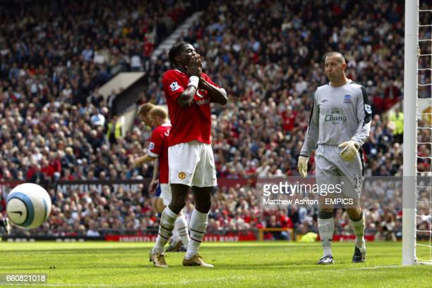 Manchester United's Louis Saha stands dejected after missing the target