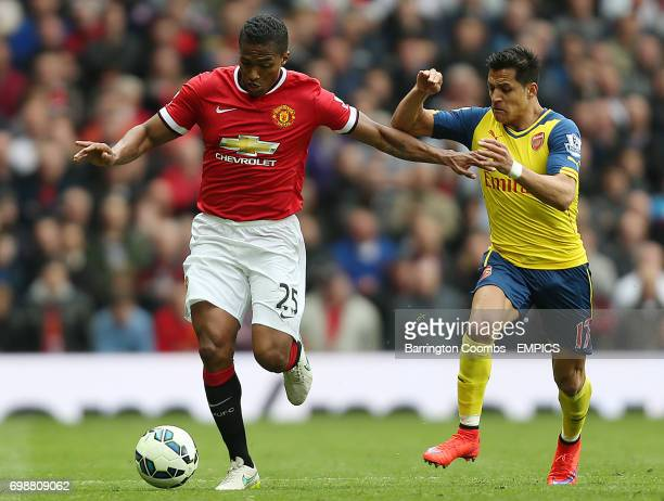 Manchester United's Luis Antonio Valencia and Arsenal's Alexis Sanchez battle for the ball