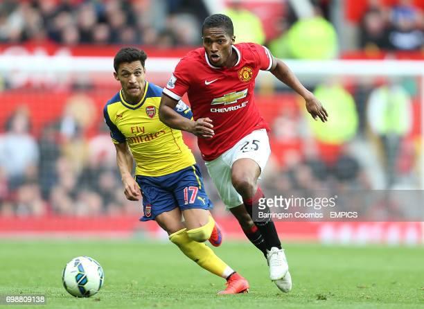 Manchester United's Luis Antonio Valencia and Arsenal's Alexis Sanchez