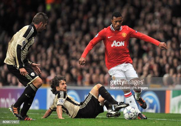 Manchester United's Luis Nani and Benfica's Pablo Aimar in action