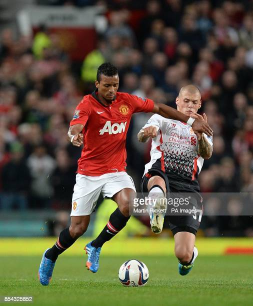 Manchester United's Luis Nani and Liverpool's Martin Skrtel battle for the ball