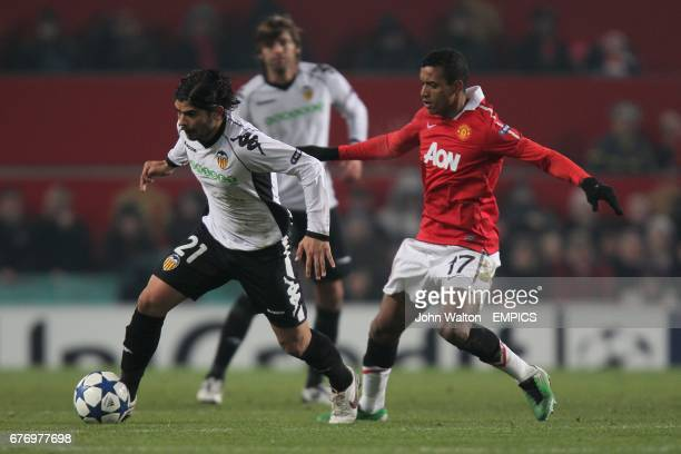 Manchester United's Luis Nani and Valencia's Ever Banega battle for the ball