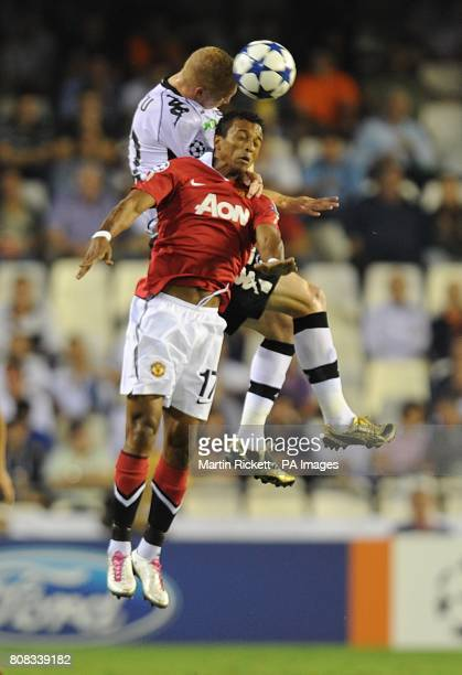 Manchester United's Luis Nani and Valencia's Jeremy Mathieu battle for the ball in the air