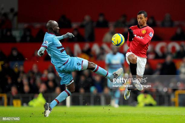 Manchester United's Luis Nani and West Ham United's Alou Diarra battle for the ball