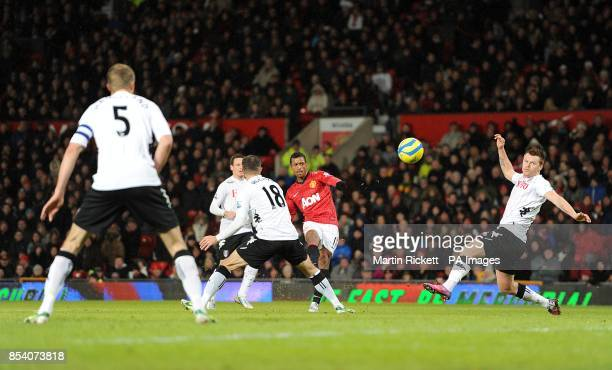 Manchester United's Luis Nani attempts to curle a shot as he is closed down by the Fulham defence