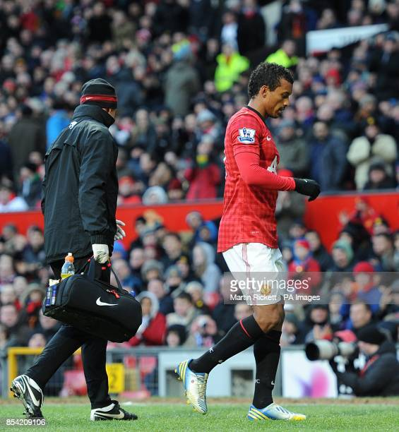 Manchester United's Luis Nani has to be substituted off the pitch due to injury