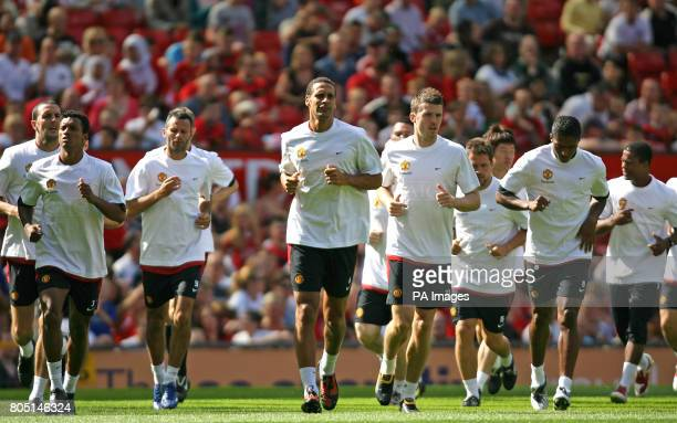 Manchester United's Luis Nani Ryan Giggs Rio Ferdinand Michael Carrick and Antonio Valencia during the training session at Old Trafford Manchester