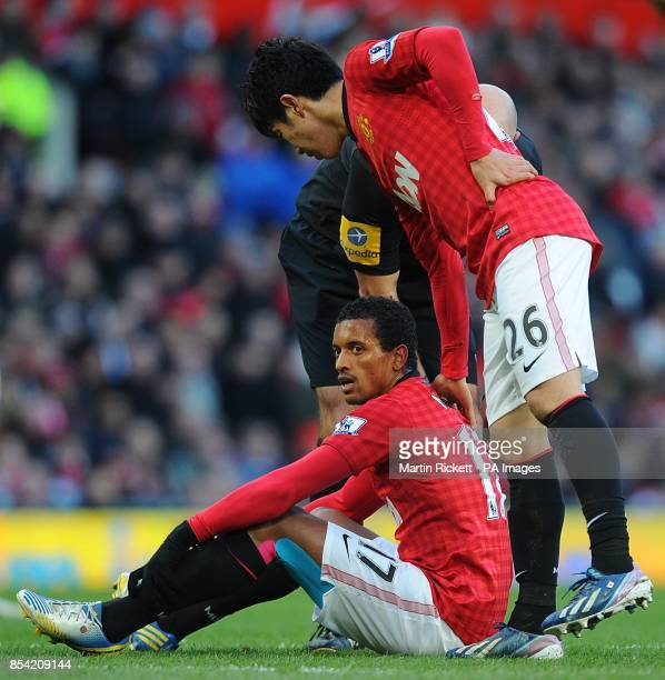 Manchester United's Luis Nani sits before he has to be substituted off the pitch due to injury
