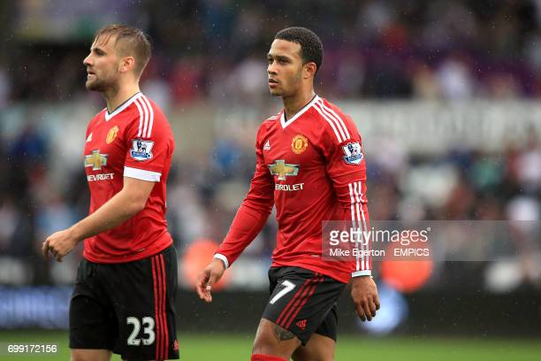 Manchester United's Luke Shaw and Memphis Depay