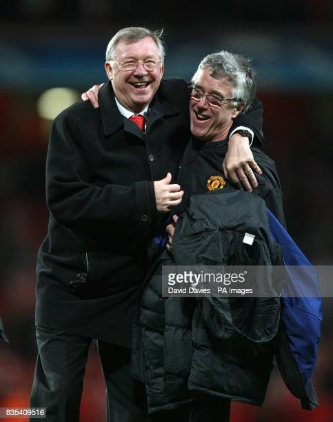 Manchester United's manager Alex Ferguson and kit man Albert Morgan celebrate after the final whistle