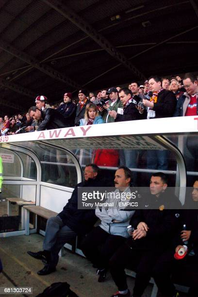 Manchester United's manager Alex Ferguson Assistant Manager Mike Phelan and substitutes Phil Bardsley and Kieran Richardson sit on the bench and...