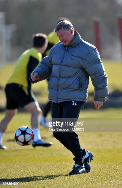 Manchester United's Manager Alex Ferguson shows some nifty footwork in training