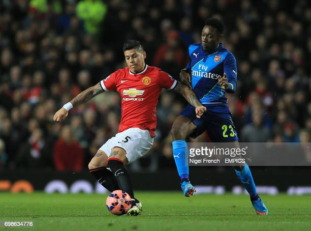 Manchester United's Marcos Rojo and Arsenal's Danny Welbeck battle for the ball