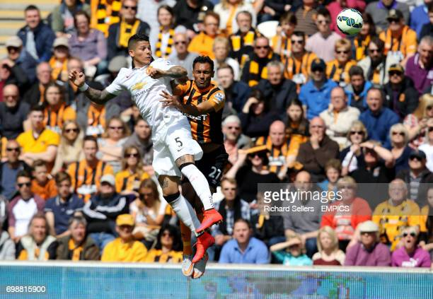 Manchester United's Marcos Rojo and Hull City's Ahmed Elmohamady battle for the ball in the air