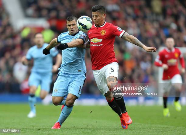 Manchester United's Marcos Rojo and Manchester City's Sergio Aguero battle for the ball