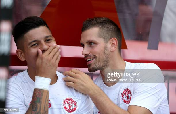 Manchester United's Marcos Rojo and Morgan Schneiderlin in the dugout