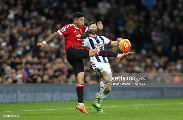 Manchester United's Marcos Rojo and West Bromwich Albion's James Chester battle for the ball