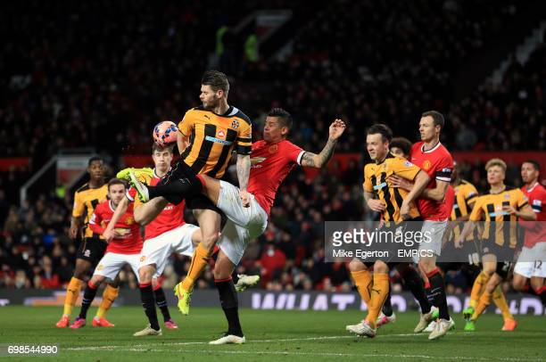 Manchester United's Marcos Rojo clears the ball under pressure