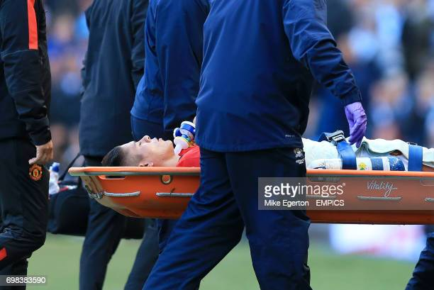 Manchester United's Marcos Rojo is carried off on a stretcher after picking up a shoulder injury