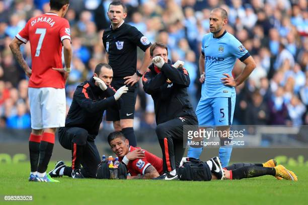 Manchester United's Marcos Rojo lies in pain after picking up a shoulder injury