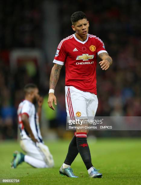 Manchester United's Marcos Rojo looks dejected after being penalised