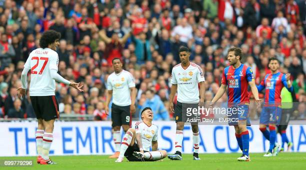 Manchester United's Marcos Rojo reacts after a collision with Crystal Palace's Damien Delaney