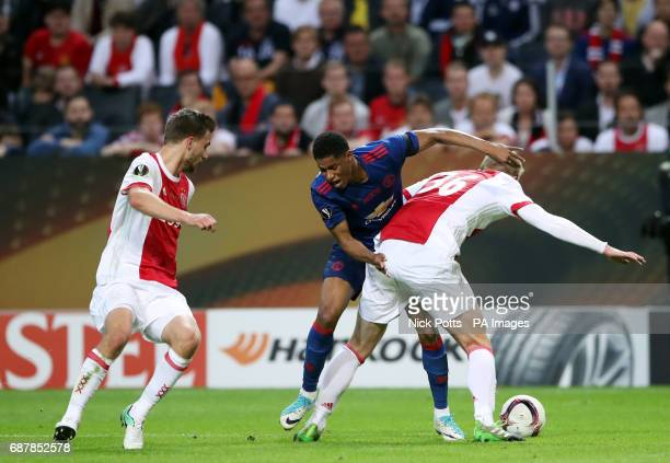 Manchester United's Marcus Rashford and Ajax's Matthijs de Ligt battle for the ball during the UEFA Europa League Final at the Friends Arena in...