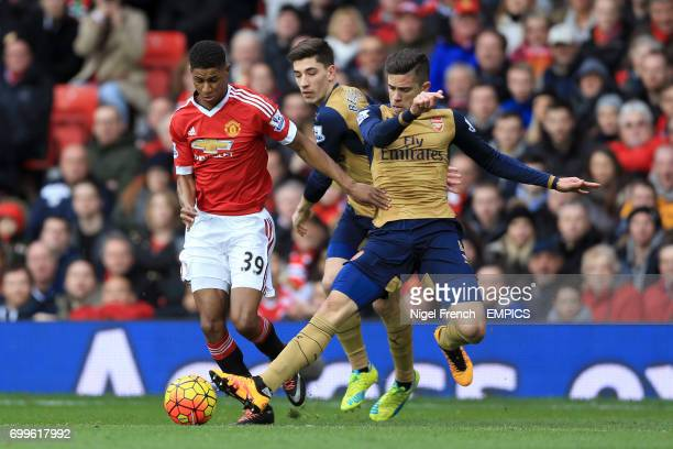 Manchester United's Marcus Rashford and Arsenal's Gabriel Paulista battle for the ball