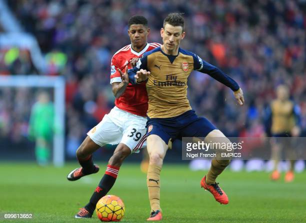 Manchester United's Marcus Rashford and Arsenal's Laurent Koscielny battle for the ball