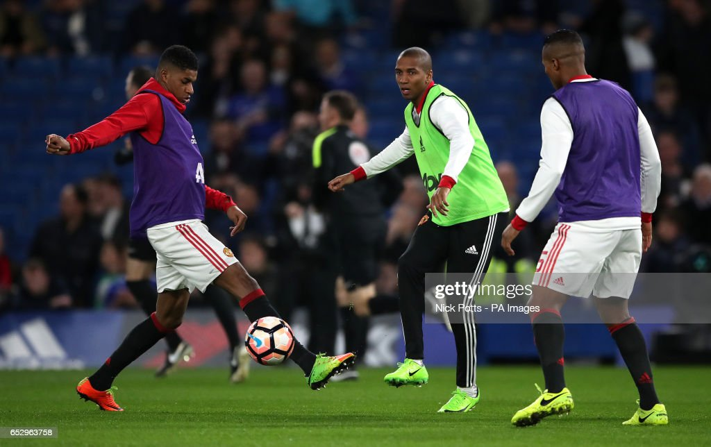 Manchester United's Marcus Rashford (left) and Ashley Young during the Emirates FA Cup, Quarter Final match at Stamford Bridge, London.