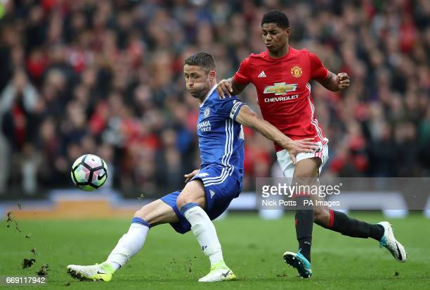 Manchester United's Marcus Rashford and Chelsea's Gary Cahill battle for the ball during the Premier League match at Old Trafford Manchester