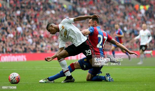 Manchester United's Marcus Rashford and Crystal Palace's Damien Delaney battle for the ball