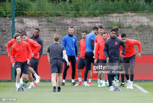 Manchester United's Marcus Rashford and Daley Blind alongside teammates during the training session at the AON Training Complex in Carrington ahead...
