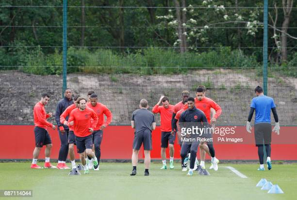 Manchester United's Marcus Rashford and Daley Blind during the training session at the AON Training Complex in Carrington ahead of the Europa League...