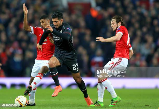 Manchester United's Marcus Rashford and Liverpool's Emre Can battle for the ball