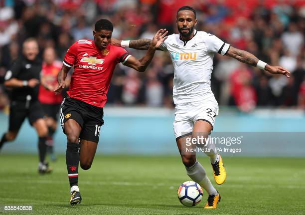 Manchester United's Marcus Rashford and Swansea City's Kyle Bartley battle for the ball during the Premier League match at the Liberty Stadium Swansea