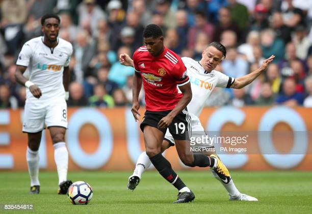 Manchester United's Marcus Rashford and Swansea City's Roque Mesa battle for the ball during the Premier League match at the Liberty Stadium Swansea